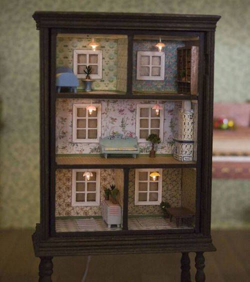 Turn an old dresser into a doll house with lights and wallpaper! Adorable and beautiful!