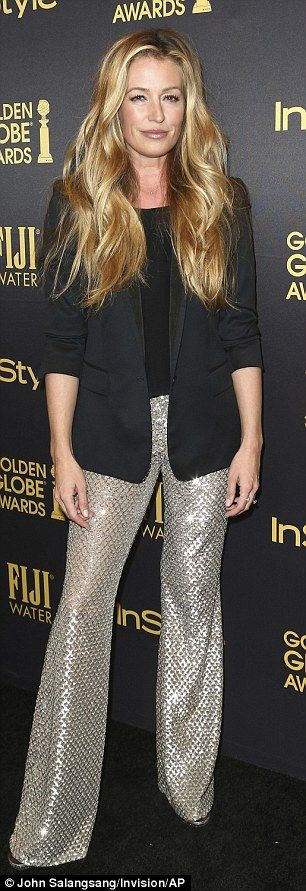 Cat Deeley showed off her flair for fashion in silver bell-bottoms...