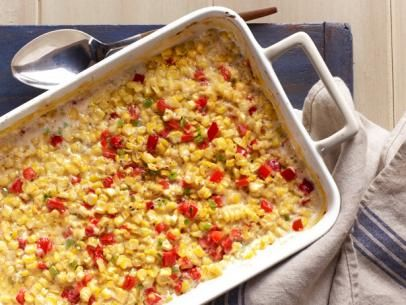 Baked Creamed Corn - Fold in red bell peppers and jalapenos to give this creamy dish a sweet-and-spicy kick.