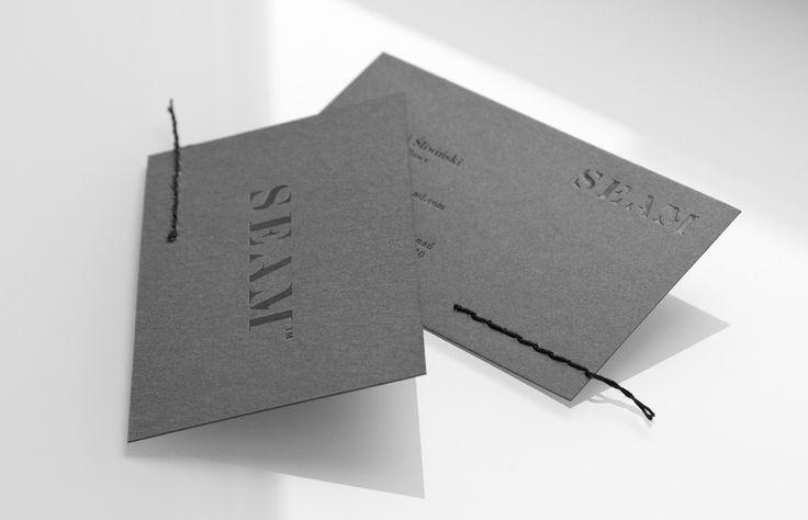 Business cards with black foil and stitched detail by For Brands for luxury clothing distributor Seam