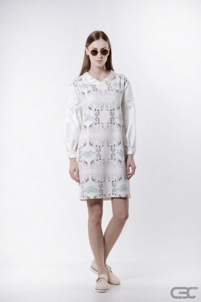 http://cbcdesign.ro/en/shop/rochie-marble/  Midi dress with digitally printed front and white suiting back, oversized sleeves and faux-kimono collar, both from a textured fabric with metallic insertions. The clean cuts make this dress easily adaptable, yet keeping a slightly sweetened vibe due to its atypical voluminous sleeves.