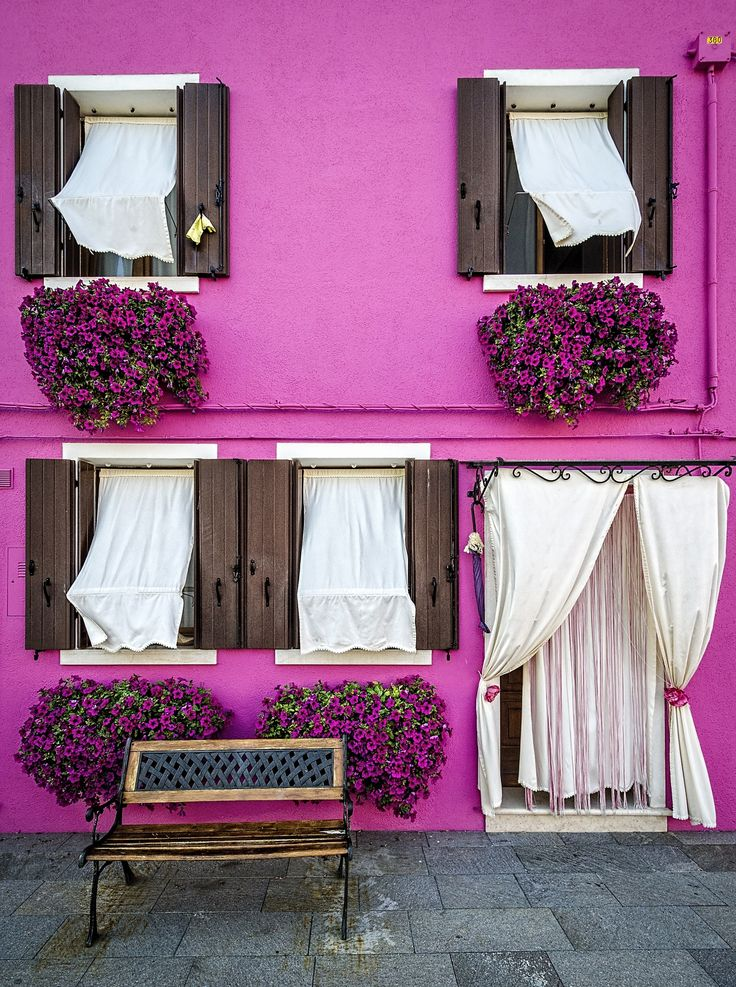 One of the numerous colourful houses on the island of Burano in the Venetian lagoon in Italy.