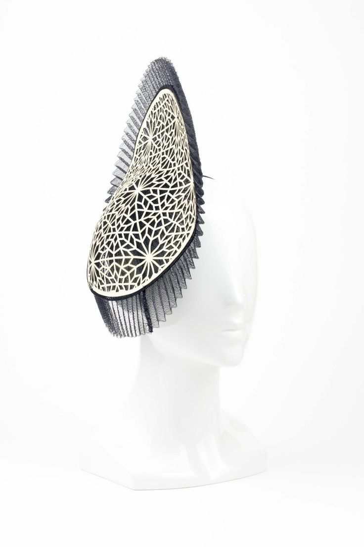 The Eternal Headonist 2014 - The Dappler - Crinoline Disc with Laser-cut Leather Geometric Design by Studio Aniss, $315.00 (http://www.theeternalheadonist.com/the-dappler-crinoline-disc-with-laser-cut-leather-geometric-design-by-studio-aniss/)