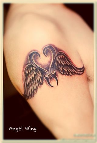 Angel wing tattoo designs on the arm with totem between two wing #angel #tattoo