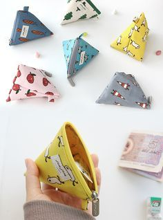 This is the cutest and most unique pouch! Shaped like a fun pyramid, it can hold your small travel cosmetics, like chapstick & hand lotion. You can also use it as a coin purse, earphone holder or as an accessory for your bags. There is 1 main zippered compartment and 1 attached cotton ring. The cotton ring can be used to hold a strap, to add your keys and charms. There are 6 irresistible and adorably designed patterns. It's also waterproof inside! What a great feature! Don't you love it…