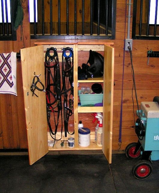 Probably the best idea ever. A cabinet right outside your horse's stall.