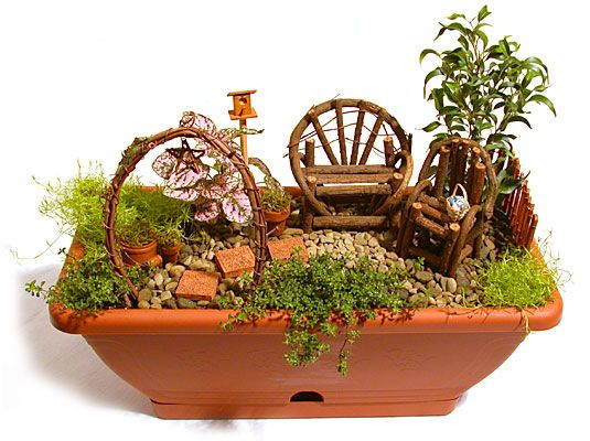 miniature fairy garden - I like the shape of this container
