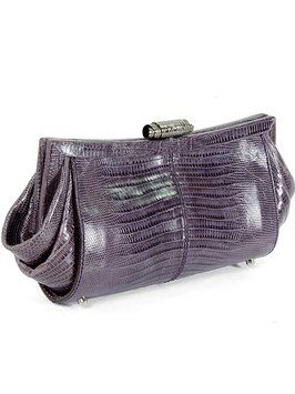 Tod's Handbag - Lizard Scala Pochette Sera Purple, Gunmetal Clutch. Get the trendiest Clutch of the season! The Tod's Handbag - Lizard Scala Pochette Sera Purple, Gunmetal Clutch is a top 10 member favorite on Tradesy. Save on yours before they are sold out!