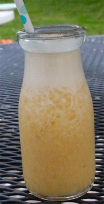 Ugli Fruit Smoothie.  1 Ugli Fruit, Peeled and Quartered  1 banana  1/4 c. pure pineapple juice  1/4 c. milk  2 Tbs. white sugar (you can totally use honey or agave nectar)  8 ice cubes