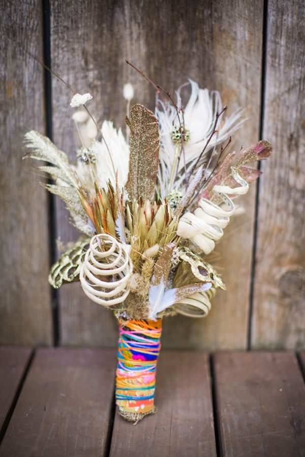 bohemian bouquet with colorful wrapping, photo by Joleen Willis http://ruffledblog.com/handcrafted-sonora-wedding #flowers #feathers #diy