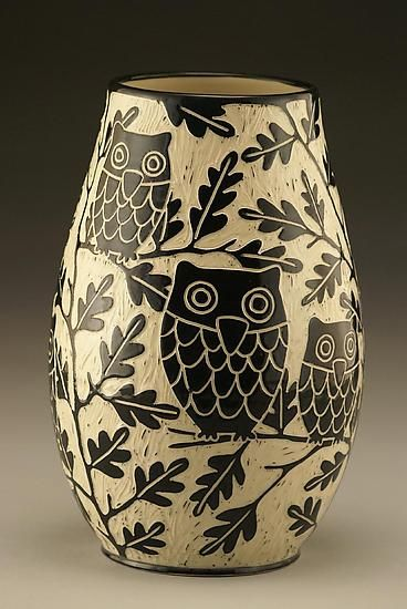 Owl Family Vase: Small by Jennifer Falter. *Wheel thrown* *porcelain* vase with whimisical owls. The surface of this vase is hand carved through a layer of black *slip* to create a contrasting and textural surface, using a technique known as *sgraffito*. Each piece is unique. Size and design may vary slightly from image shown. Signed on the bottom.