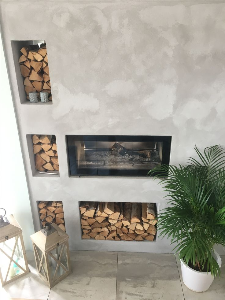 Fireplace design by Erik Brekke and chalk painted over the concrete.