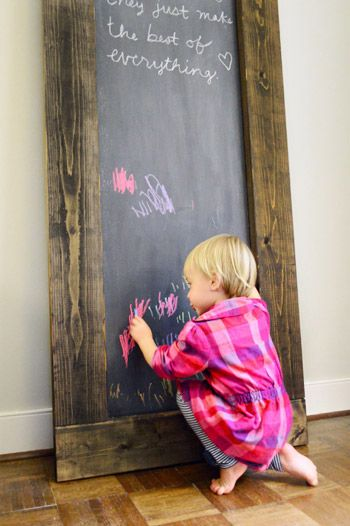 Possible DIY Hall Decor.     A scrap piece of plywood + some cheap framing lumber + stain + chalkboard paint = this rustic, oversized chalkboard for our living room. Plus we added some already-owned magnet paint to make it magnetic too.