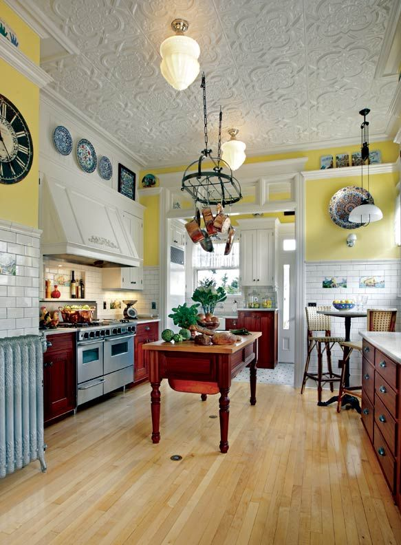 i love the sunny color, the tin ceiling, the island...i love it all.