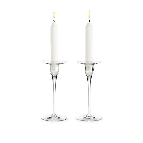 An elegant design detail that reinterprets the classic candle holder and provides an exciting optical effect. The Cabernet Candle Holder is available in three sizes: as shown measuring 18 cm and two smaller versions measuring 12 cm or 15 cm. An ideal gift idea for any occasion.  #holmegaard #cabernet #candleholders