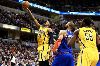Forward Paul George (24) of the Pacers, scoring on Tyson Chandler
