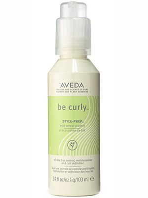 Aveda Be Curly Style-Prep defines curls and prevents frizz....