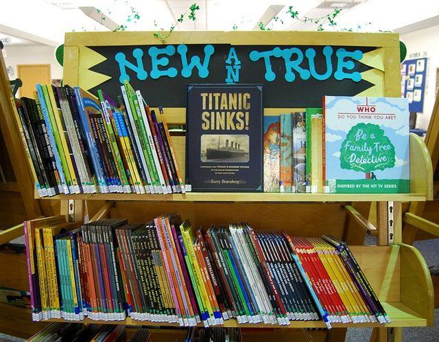 """New & True"" library book bulletin board display"