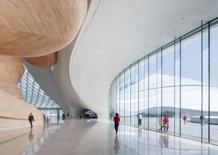 Mad 39 s sinuous harbin opera house completes in china for Beijing opera house architect