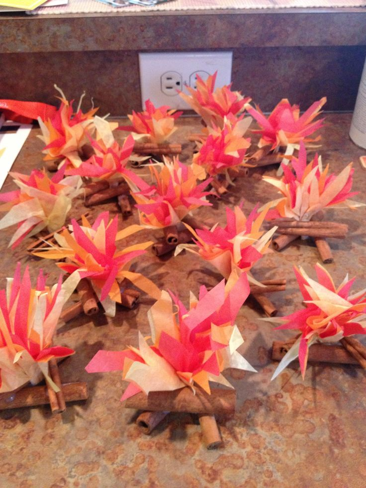 Mini campfires for table decorations. Used cinnamon sticks for wood. Turned out so cute!