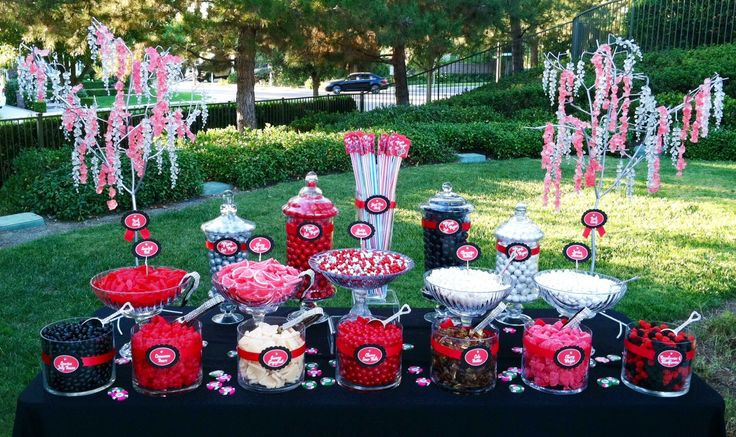 Poker Tournament fundraiser Candy Buffet. Red and Black Themed. Turned out so cute. It was featured in the local paper with 2 photos!   Jorden Collins Candy Buffets 949-231-2098