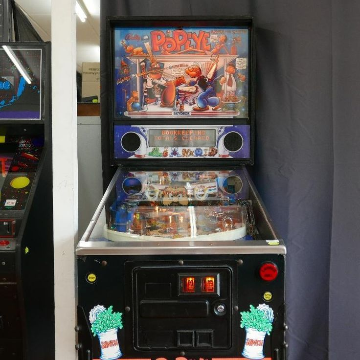 """Bally """"Popeye saves the earth"""" amusement pinball machine - board and surface condition excellent, fully operational. Available at our collectables auction."""