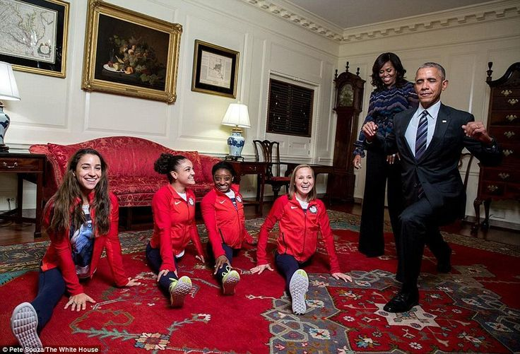 President Barack Obama attempts to do the splits with the gold medal winning Women's Gymnastics Team during a visit to the White House on Thursday