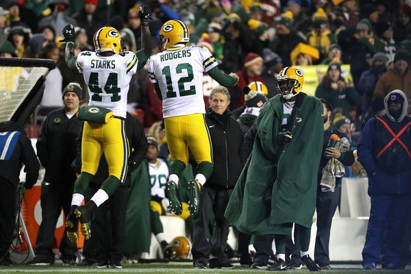Aaron Rodgers Photos Photos - Running back James Starks #44 of the Green Bay Packers celebrates with teammate quarterback Aaron Rodgers #12 of the Green Bay Packers after scoring a fourth quarter touchdown against the Washington Redskins at FedExField on November 20, 2016 in Landover, Maryland. - Green Bay Packers v Washington Redskins