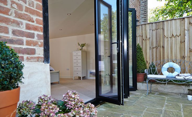 Patio Set of Black aluminium Bi-Folding doors, for your free quote on your own set of bi-folding doors visit www.csggroup.co.uk