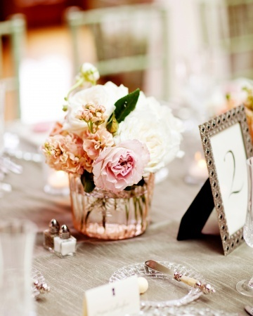 Antique-cut vases filled with garden roses, stock, and ranunculus #wedding #DIY centerpiece