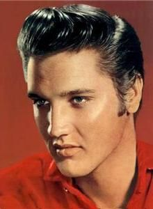 Elvis spotting his signature 50's men's quiff hair style.  The quiff is a hairstyle that combines the 1950s pompadour hairstyle, the 50s flattop, and sometimes a mohawk.