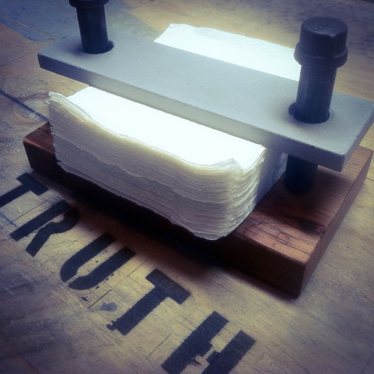 #Industrial look #concrete, black #pipe and #reclaimed #wood napkin holder by…