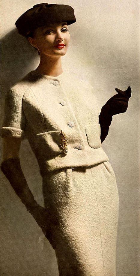 1957 Evelyn Tripp in elegant nubby wool suit by George Carmel.