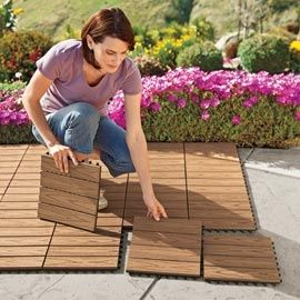 I wish I had known about these years ago! My porch would have been so much nicer. Vifah Deck Squares Turn boring cement into a beautiful wood-look deck that won�t rot splinter or split. Can get at ikea.