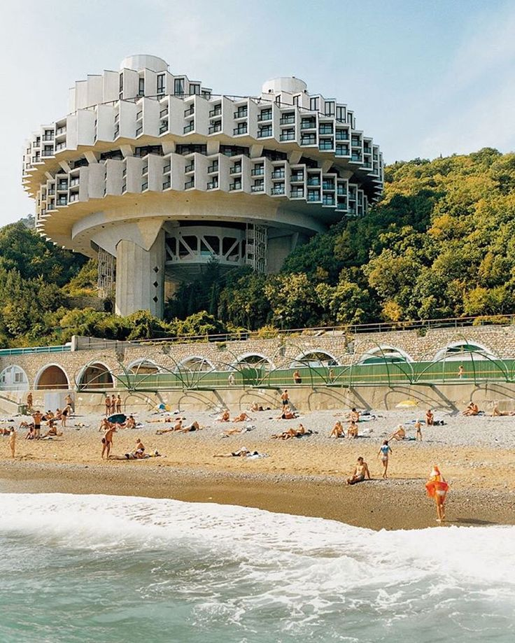 Sci-fi movie set? No. This is the Druzhba (Friendship) Sanitarium in Yalta, Ukraine, designed by Igor #Vasilevsky and completed in 1986. The swimming pool, dance hall, and cinema complex overlooks a beach in what was then a popular resort town.  #Yalta, #Ukraine, 1985 © Frédéric #Chaubin