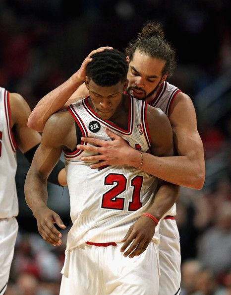 Joakim Noah #13 of the Chicago Bulls hugs teammate Jimmy Butler during Game Two of the Eastern Conference Quarterfinals during the 2014 NBA ...