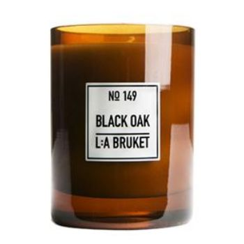L:A Bruket Large Black Oak Scented Candle: The fragrance of L:A Bruket's Black Oak Candle is a rich scent of Nordic woods - blackened oak, birch and cashmere wood.  Produces a powerful & natural aroma, made from organic soy wax, hand poured into mouth blown glasses by skilled craftsmen.