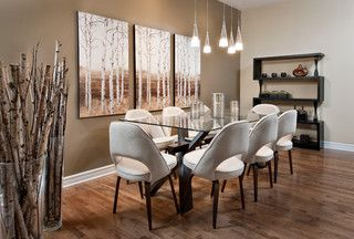Contemporary dining room with a birch theme - birch tree paintings, birch logs in the large glass vases and yellow birch hardwood floors by Eterna.