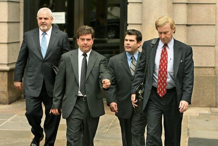 Brothers Michael and Jeffrey Derderian, center left, and center right, depart Superior Court, in Providence, R.I., Friday, May 26, 2006, accompanied by their new attorney, Anthony M. Cardinale, left, and their former attorney, Jeffrey B. Pine, right. Superior Court Judge Francis J. Darigan Jr. approved Pine's request to withdraw as attorney for Jeffrey Derderian. The brothers each face involuntary manslaughter charges for the Feb. 20, 2003 fire at The Station nightclub in West Warwick, R.I…