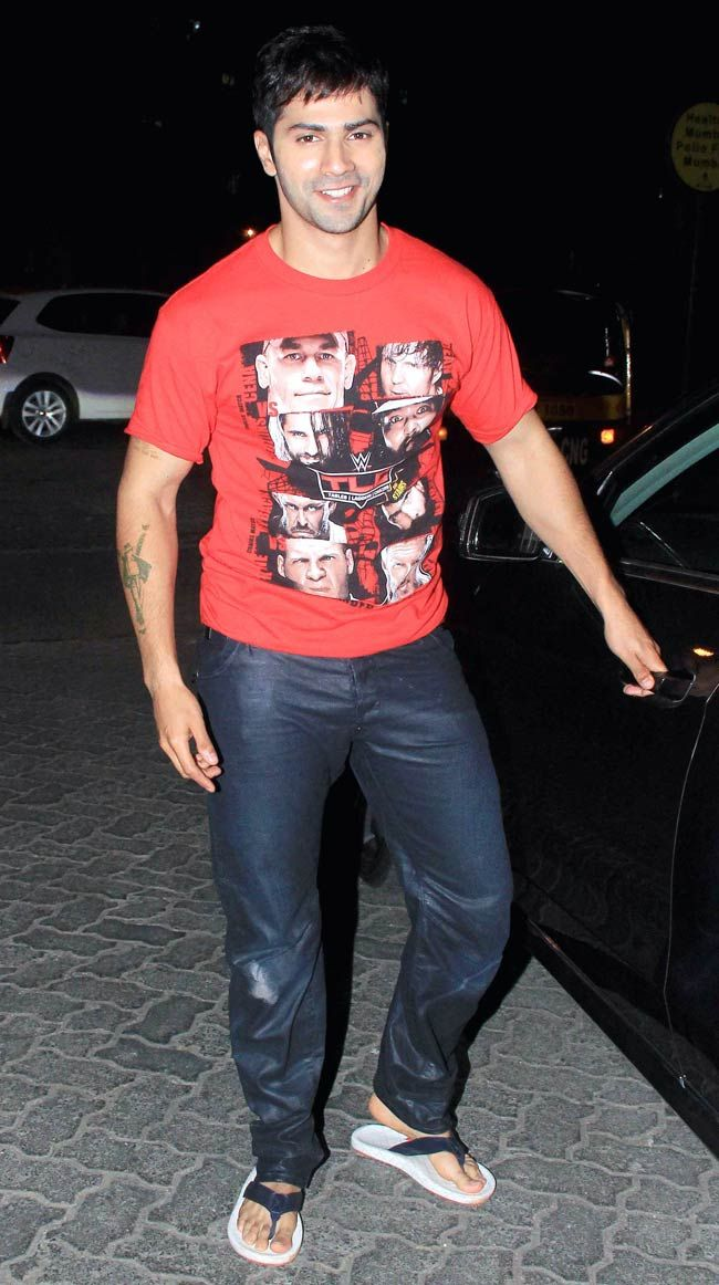 Varun Dhawan smiles for the shutterbugs before entering his car outside PVR, Juhu. #Bollywood #Fashion #Style #Handsome