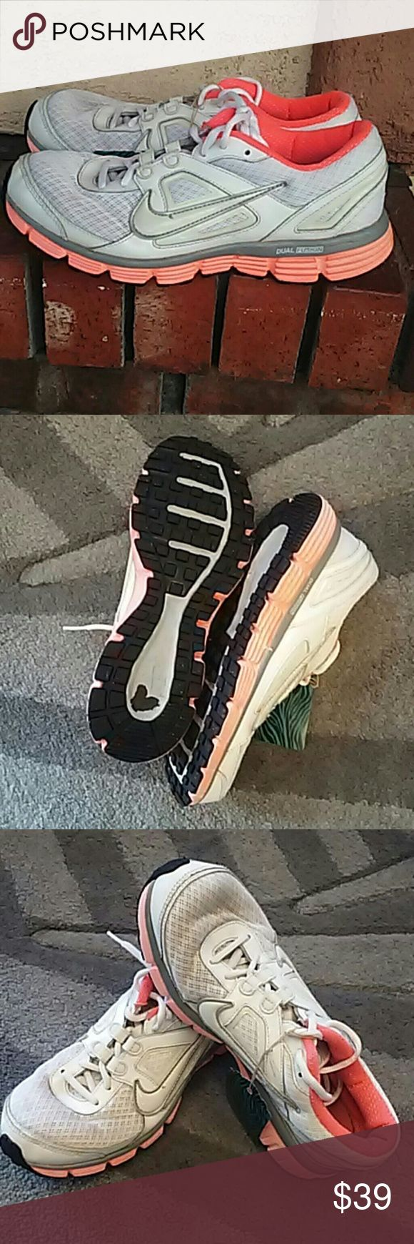 Women's Nike Dual fusion shoes White and coroal orange Nike Dual fusion tennis shoes. In excellent used condition bottoms don't look used. See pic #2 sold as is see all pictures and ASK all questions before you purchase. Dont need unnecessary RETURNS. Thank you Nike Shoes Sneakers