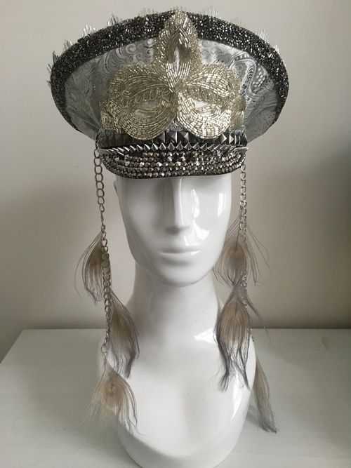 Silver captain style military peaked cap with silver sequins and peacock…