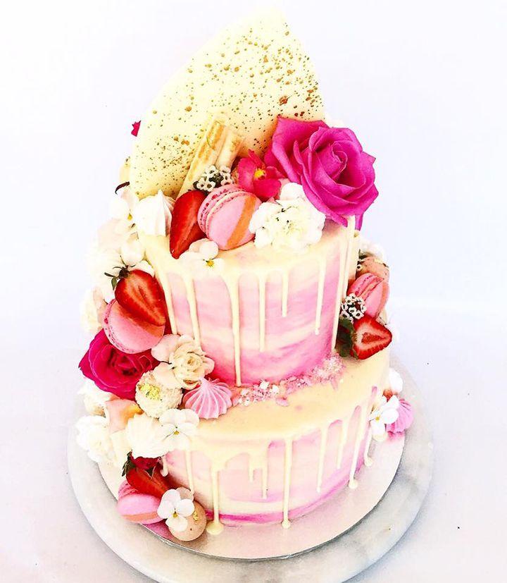 Dessert Stomach's pretty white chocolate ganache drip cake with meringue kisses, macarons, berries, flowers and white chocolate wafers ~ we ❤ this! moncheribridals.com