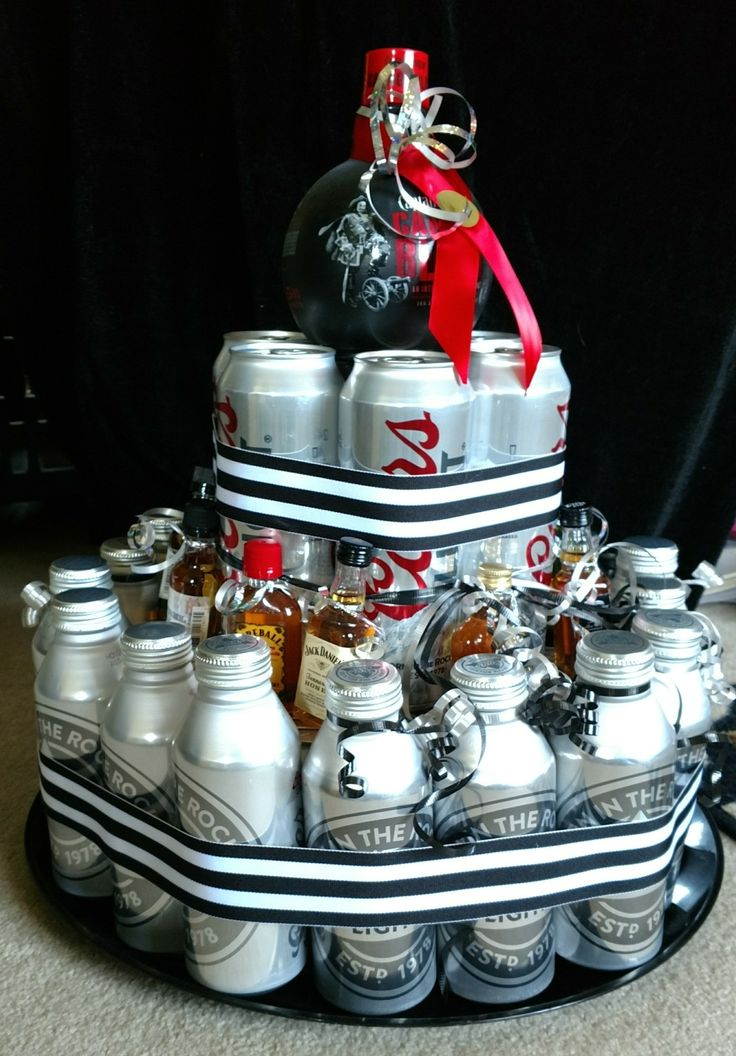 Beer & Liquor Cake - 12 oz beer cans + 16 oz beer bottles + 24 oz beer cans + 10 mini liquor bottles + 1 Captain Morgan cannon ball.  I made my great friend day for his 50th birthday.