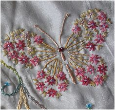 I ❤ embroidery . . . Vogart butterfly I found this pattern here sweetbe.blogspot.com.au/2010/01/vogart-692.html It is on a Round Robin block. Another of my bad photos as the flowers are finer than they appear here and the colours are nicer. I used a single strand Stef Francis thread for flowers, Rajhmal rayon for the body and wing ribs and DMC single thread for the green leaves.