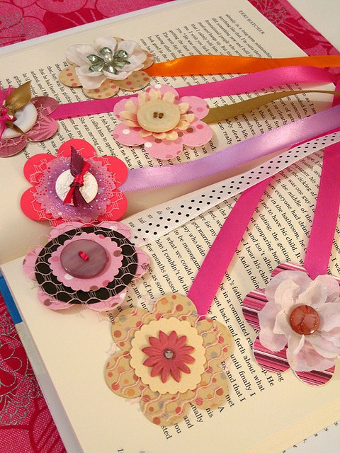 book marks - punch ribbon and flower and attach with brad - laminate flower be for putting on buttons and cloth - may put another flower on the bottom of book mark as well