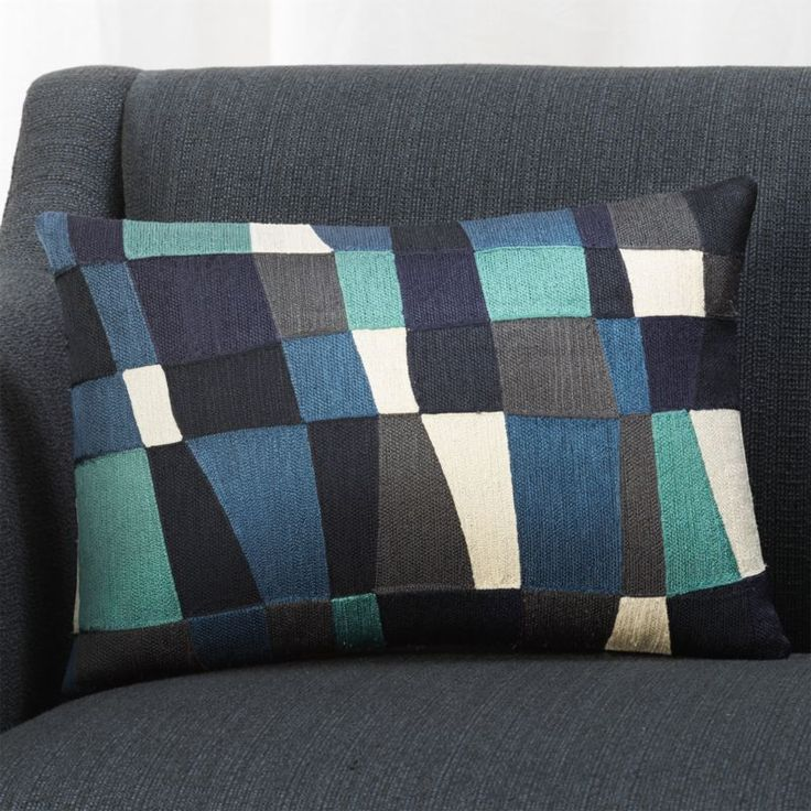 Shop Kinsey 18x12 Blue Pillow.  Asymmetrical blocks embroidered in beautiful shades of blue add modern-art geometry to solid sofas or chairs.  Pillow reverses to solid blue.