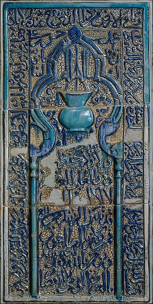 Scholars have proposed that this large three-piece <i>mihrab</i>-shaped panel once adorned the tomb of the Sufi shaikh 'Abd  al-Samad in Natanz.  In addition to its selection of Qur'anic verses, the panel includes an inscription describing itself as the work of Hasan ibn 'Ali ibn Ahmad Babavaih, a known fourteenth-century tilemaker from Kashan