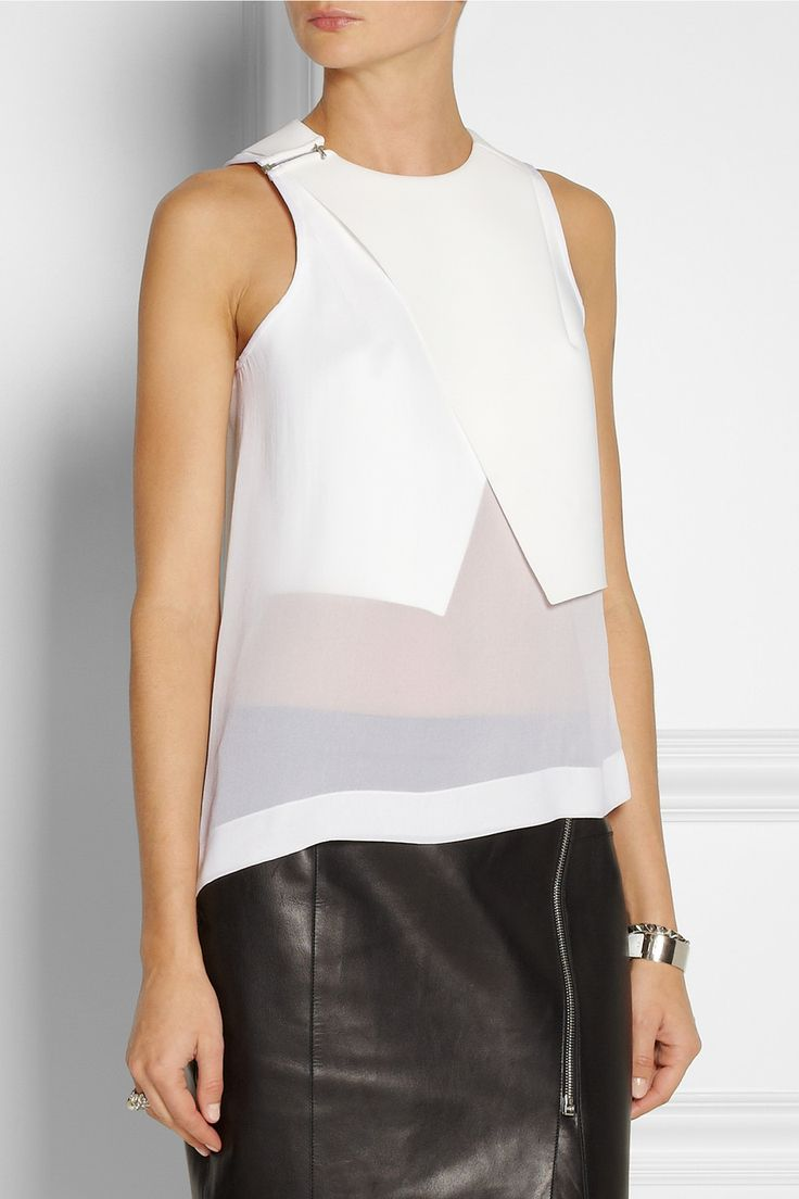 The layered construction of this garment immediately makes it feel really unique and expensive to the shopper. Also, technical fabrics like the bonded jersey used in this garment can sometimes feel cheap, so putting the silk georgette next to the skin makes for a great wearing experience. Putting the closure at the shoulder is unusual and keeps the architectural construction of the bodice undisturbed.  Dion Lee|Windfall bonded tech-jersey and silk-georgette top