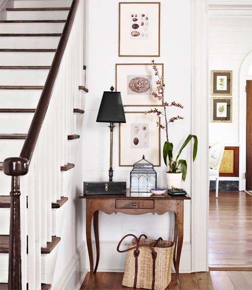 These homeowners decorated their entrance hall with a high-low mix: A custom tiger-maple table pairs with bargains like a terrarium from T.J. Maxx and artwork scored on eBay. Plus: 40+ before-and-after home makeovers »   - CountryLiving.com